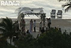 Depp and Heard hold hands while gazing at one another johnny-depp-wedding-photos-17