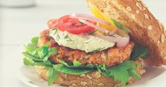 Smoked Salmon Burger with Lemon Aioli. Salmon fillets and smoked salmon are combined with dill and other seasonings to make this clean and lean patty stand out. Lemon and herb aioli give this burger an extra lift of flavor. Burger Recipes, Salmon Recipes, Fish Recipes, Seafood Recipes, Clean Eating Recipes, Healthy Eating, Healthy Recipes, Eating Clean, Healthy Food