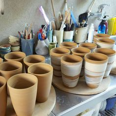 Mugs-to-be, still damp, after slip decoration and before handles attachement. The ones without slip are going to be new turquoise mugs...look it up next week...
