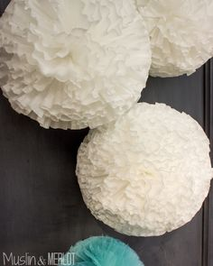 Tired of tissue paper poms? Looking for something a bit different? Use coffee filters to make lovely poms!