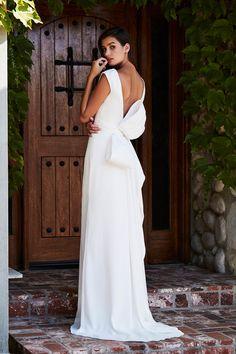 Sheath wedding dress with V-back and oversized bow