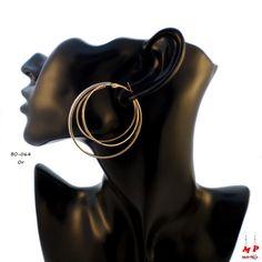 Boucles d'oreilles triple anneaux dorés et paillettes argentées. Diamètre: 4,9cm.