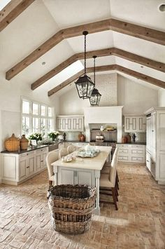 Love the vaulted ceiling and wood beams in this kitchen!