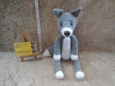 Crochet grey wolf soft animal crochet toy by kingsnqueenscrochet