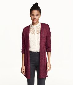 Fine-knit cardigan in soft yarn with dropped shoulders, long sleeves and a tie belt at the waist.
