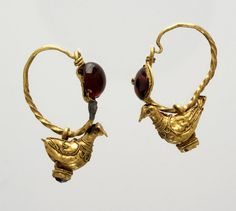 RISD Museum: Unknown artist, Greek. Pair of earrings with dove pendants, 3rd century BCE. gold; garnet. 2.5 x 0.4 cm (1 x 3/16 inches) intact piece; of stone setting underneath. Gift of Ostby & Barton in memory of Englehart Cornelius Ostby 22.177