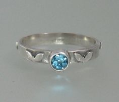 Blue topaz engagement ring with heart leaves handcrafted by Kryzia Kreation  shttp://www.kryziakreationsstudio.com/products/blue-topaz-engagement-ring-with-heart-leaves-in-sterling-silver  $185.00