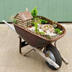 mini garden in a wheel barrow