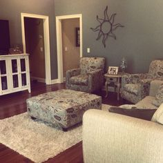 A loyal customer sent us this photo of her beautiful living room! 2 Fusion chairs, couch, ottoman, & TV cabinet all from Lewis Furniture Store!