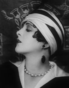 The necklace & earrings often did not match. ALady.1920's Fashionable. Hats of this style need to make a comeback. So much less hairstyling