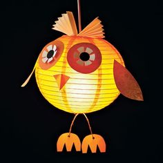 Owl A Glow: Assembled from a paper globe lantern and scrapbooking paper, our wise owl friend makes a great Halloween decoration.