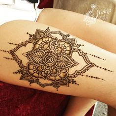 Thigh mandala henna design by Divine Henna.