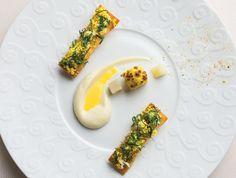 """Crispy Scottish langoustines """"à la Polonaise,"""" cauliflower-vadouvan velouté, glazed sunchoke, parsley salad."""