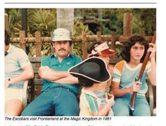 Pablo Escobar looking just about as thrilled as any other father at Disney World.