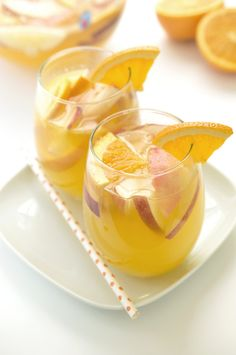 This White Wine Sangria is sure to be a crowd-pleaser. It is ready in less than 5 minutes! Made with fresh peaches, oranges, triple sec, and orange vodka. Fruity Red Wine, Sangria Cocktail, White Wine Sangria, Cocktails, Peach Sangria Recipes, Vodka Recipes, Party Recipes, Drink Recipes, Vegetarian Tapas