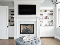 California Beach House Design - Master Bedroom: A cozy sitting area with fireplace flanked by built-ins.
