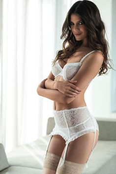 bd24f5e42e Top fashion model woman in seductive lace bra with with supsenders with  thong panties and stockings lingerie posing for photo shoot.