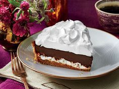 Over the Moon Chocolate Pie Recipe | This mile-high chocolate pie is inspired by a Southern classic: the MoonPie. With a graham cracker crust, a Tennessee whiskey-chocolate filling, and marshmallowy meringue, this pie is sure to impress.