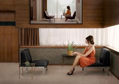 Erwin Olaf; enigmatic portrait of person in their mid century modern living room