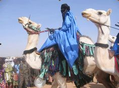 Tuareg man on camel in Niamey, capital of Niger, West Africa.  Want to go back!