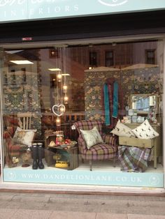 This window display can work great: creating a lovely room set-up by using all the different products in stock in a charity shop