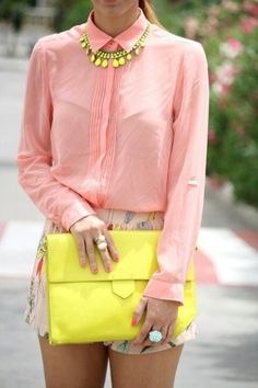 yellow purse and necklace pastel pink blouse with multicoloured shorts