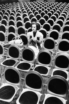 Alfred Eisenstaedt - Jane Froman knitting while sitting in audience seats at radio rehearsal, 1936