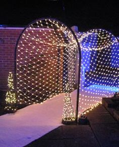 two arches of different height/width and weaving lights to make a short tunnel?