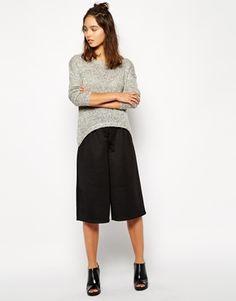 W/ a tight black midi top, preferably polo neck. I see it