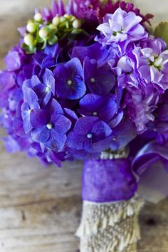 Blue & purple flowers - perfect for a vineyard or rustic wedding.