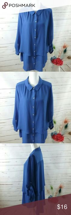 Lane Bryant Royal Blue 22-24 Tunic Blouse This is a lovely Lane Bryant size 22/24 tunic blouse. It is 100% polyester. It is a royal blue with silver buttons. It is a long tunic blouse with an overlay so it is tiered. Has 3/4 sleeves with epaulets. It is sold in great preowned condition with no stains or flaws. Lane Bryant Tops Blouses