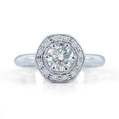 Moissanite Hexagon Engagement Ring      0.50 carat moissanite in white gold with hexagon diamond halo.