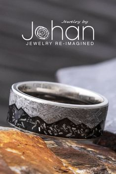 Gibeon meteorite and black stardust decorate the inlay of this handmade wedding band from Jewelry by Johan. #JewelrybyJohan