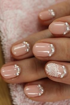 For the adventerous bride, this rhinestone-rimmed look will have your guests oggling not only your ring but your #mani! #bridalmani