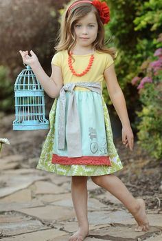 Dress by My Little Jules boutique. Giveaway going on now!  http://www.fabulousfunfinds.com/2012/02/my-little-jule-pin-it-to-win-it-easter.html