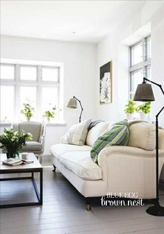 Lamps, couch, small green accents- love it all