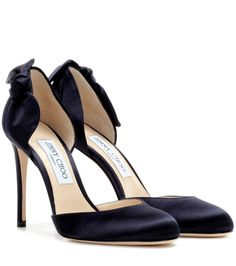 Jimmy Choo - Kay 100 satin pumps - Jimmy Choo crafts the Kay 100 pumps from lustrous navy satin for an evening-appropriate look of glamour. The open d'Orsay sides are highlighted with a single bow on the outer side to add feminine detail to the round-toed pair. The slender heel will elongate your leg-line next to midi hemlines. seen @ www.mytheresa.com...