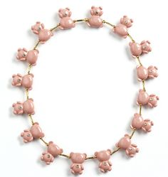 Fine teddy bear jewelry made of porcelain and gold-plated silver.  By Ana João of Matosinhos, Portugal.