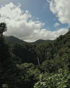 La Fortuna Waterfall, Costa Rica. Lush jungle vegetation surrounds epic waterfall. Flights+Barrels Travel Photography.