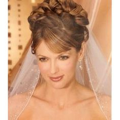 Wedding hair with bangs and veil
