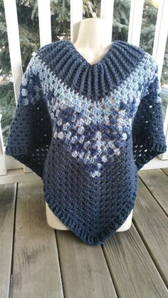 Hot Off My Hook! Project: Cowl Neck Poncho Started:  27 Jan 2016 Completed: 29 Jan 2016 Model: Madge the Mannequin Crochet Hook(s): 7mm, Cowl portion, K, Granny Stitch portion Yarn: I Love This Yarn Color(s): Dark Denim, Stonewash, Denims Ombre Pattern Source: Simply Crochet Magazine, Issue No. 25 (Hard Copy) Pattern Designed By: Simone Francis Notes: This is my 71st Cowl-Neck Poncho, and the 3rd time I've used these exact colors.