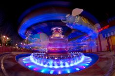 Magic Kingdom - Dumbo's Back by SpreadTheMagic, via Flickr.    LOVE the colors in the Dumbo area of New Fantasyland :)