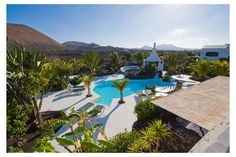 Stylish Lanzarote Retreats & Vineyard Accommodation with private Villa & Apartments available in Rural Lanzarote Villa, Palmiers, Organic Farming, Vineyard, Places To Go, Architecture, House Styles, Outdoor Decor, Travel