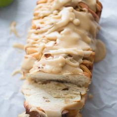 Caramel Apple Pull-Apart Bread Recipe Breads with warm water, active dry yeast, granulated sugar, butter, sugar, salt, eggs, milk, bread flour, butter, granny smith apples, brown sugar, cinnamon, corn starch, glaze, butter, brown sugar, salt, caramels, vanilla, powdered sugar