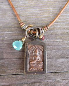 Dharmashop.com - Brass and Copper Buddha Necklace, $85.00 (http://www.dharmashop.com/brass-and-copper-buddha-necklace/)