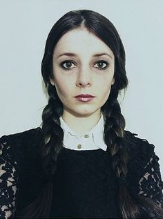 There's no better way to channel creepy-chic girl power than to dress up as Wednesday Addams. Get your deadpan face and your favorite black dress ready . . . and don't forget the braids!                  Image Source: Instagram user carrieboo