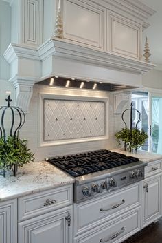 Well-dressed Traditional Kitchen | tile backsplash, hood design.