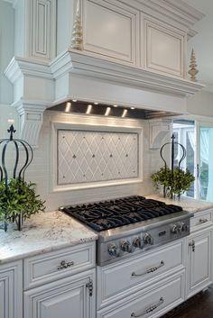 Well-dressed Traditional Kitchen | tile backsplash, hood design.
