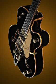 Dream Guitar #2. You can't tell me that this isn't absolutely gorgeous. This Gretsch Black Falcon is golden beauty.