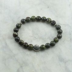 Mala Bead Bracelet for wellness, enhancing life force, balance, and protection. #malabracelet #dragonbloodjasperbeads